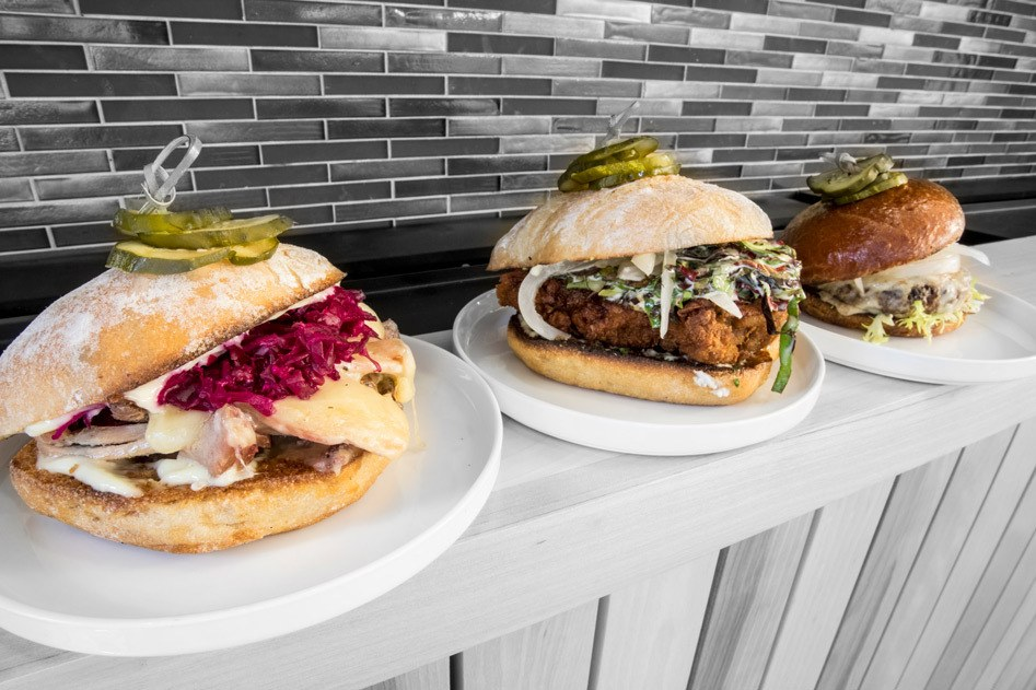 House made large plates featuring the house burger, fried chicken sandwich, and the roasted turkey dip.