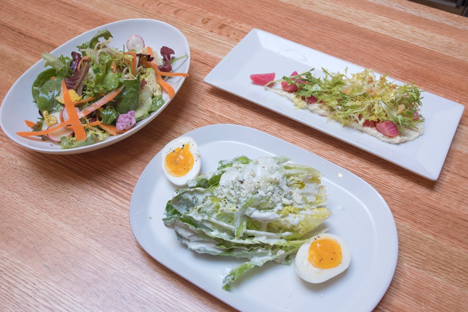 Perch & Plow salad variations featuring a variety of flavors.