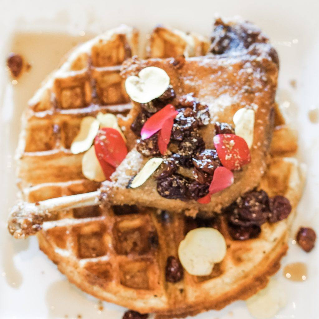 waffle with duck leg on top and toppings