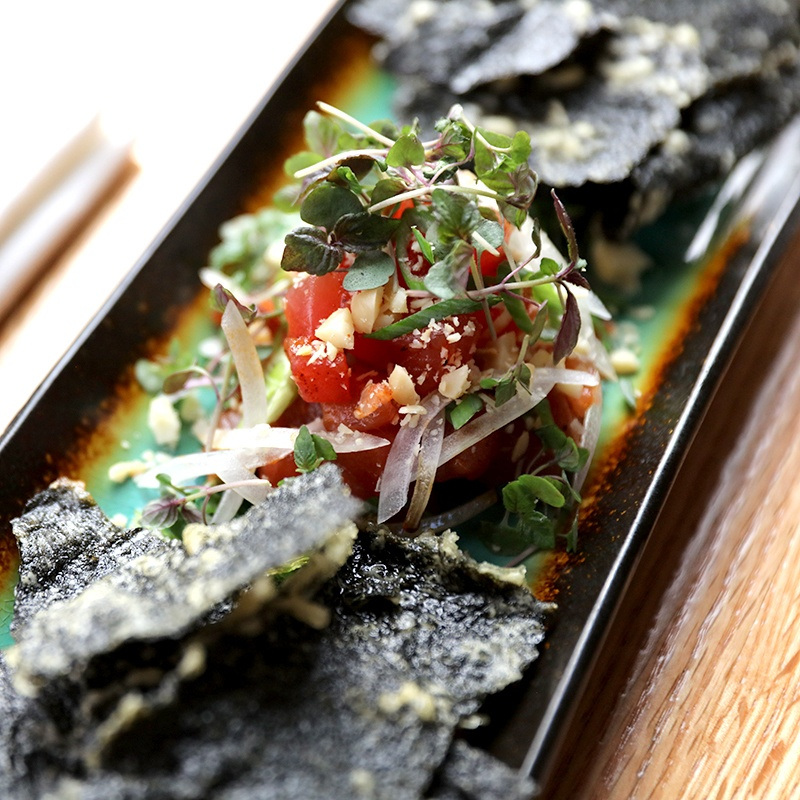 plate with tuna poke in the middle and nori crackers to the side